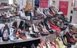 Sale racks circle the shoe department at Saks Fifth Avenue