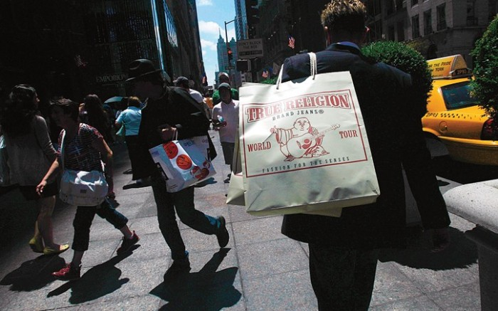 Shoppers strolled Fifth Avenue in New York
