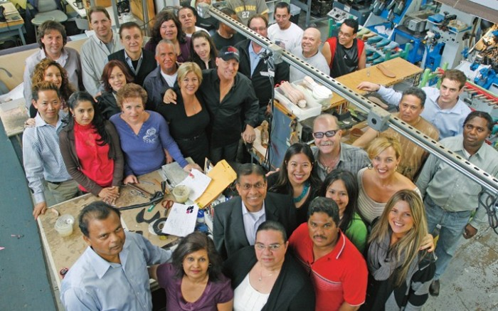 Madden center in hat with some of the firm&#8217s first employees photographed for FN on Nov 11 at the company headquarters