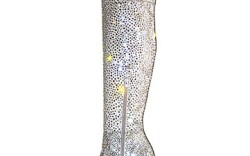 Stuart Weitzman&#8217s latest glam-tastic creation a silver satin over-the-knee boot on a 5 12-inch heel adorned with 22000 Swarovski crystals