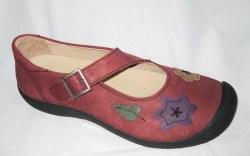 Asymmetric-strap shoe with appliqu&#233s by Haflinger