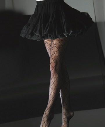 CYNTHIA ROWLEY&#8217s large fishnet stockings