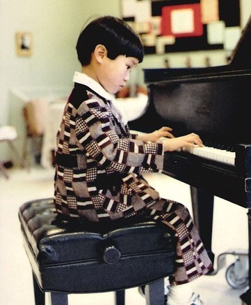 Hsieh playing his instruments at age 7