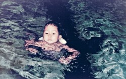 Hsieh jumping off the diving board at age 4