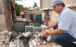 Wayne Elsey inspecting shoes on the streets of Delmas