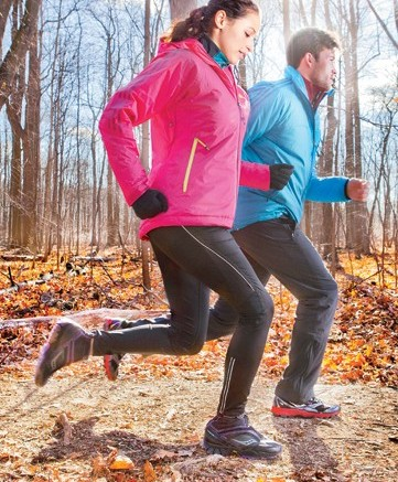 Her SAUCONY&#8217s trail-running shoe with softshell gaiter Blue zip-up by Columbia worn inside jacket jacket by Adidas leggings by New Balance Him Trail runner with dynamic posting from MONTRAIL Red zip-up by Brooks jacket and pants by Adidas