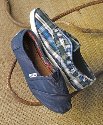 TOMS SHOES&#8217 distressed slip-on and KEDS&#8217 plaid skimmer with ruffle detail