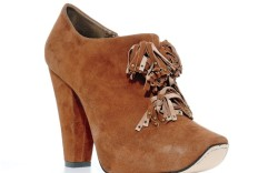 Suede bootie with tassel trim by REED EVINS