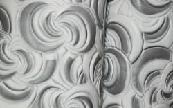 Embossed painted swirls from Gemini