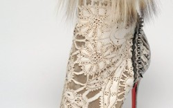 Christian Louboutin&#8217s laser-cut mid-calf boot with snakeskin studs and fur showcases a clever use of luxury materials