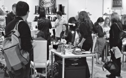 Shoppers in the Steve Madden booth at the ENKWSA trade show