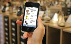Phone showing footwear ecommerce site of