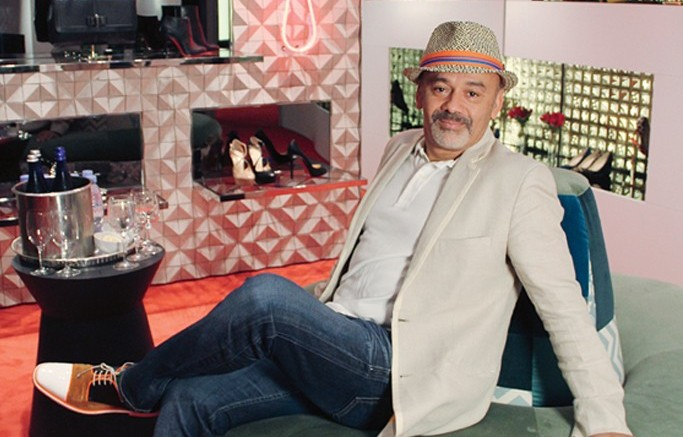 Christian Louboutin inside his first US shop-in-shop at Saks Fifth Avenue