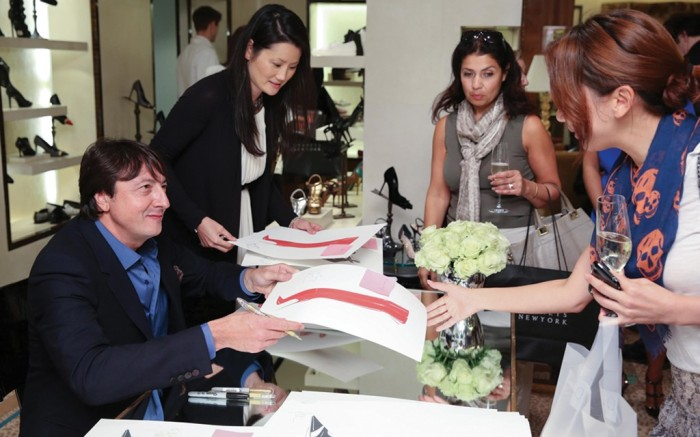 Gianvito Rossi signs  sketches at Bergdorf Goodman