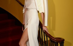 Model Constance Jablonskis cutout pump complements slashed-skirt suit at at Mario Testinos Alta Moda opening at The Spanish Institute Steve Eichner
