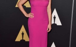 At the Academy of Motion Picture Arts and Sciences Governors' Awards in Hollywood, Witherspoon toned down her bright pink Ralph Lauren look with nude sandals.