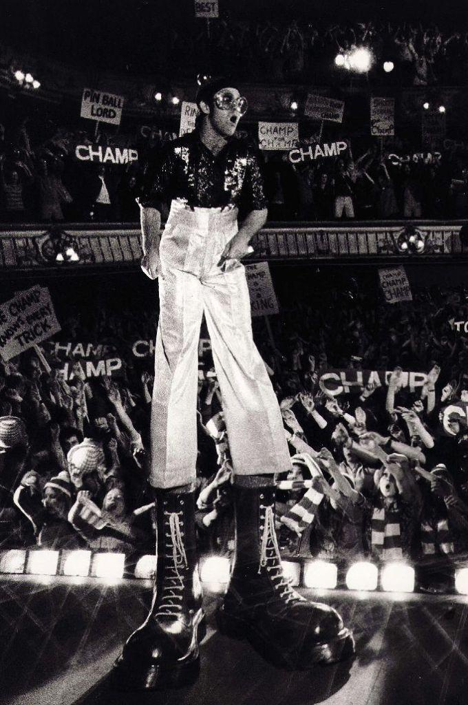 Elton John , giant combat boots, 1975, celebrity style
