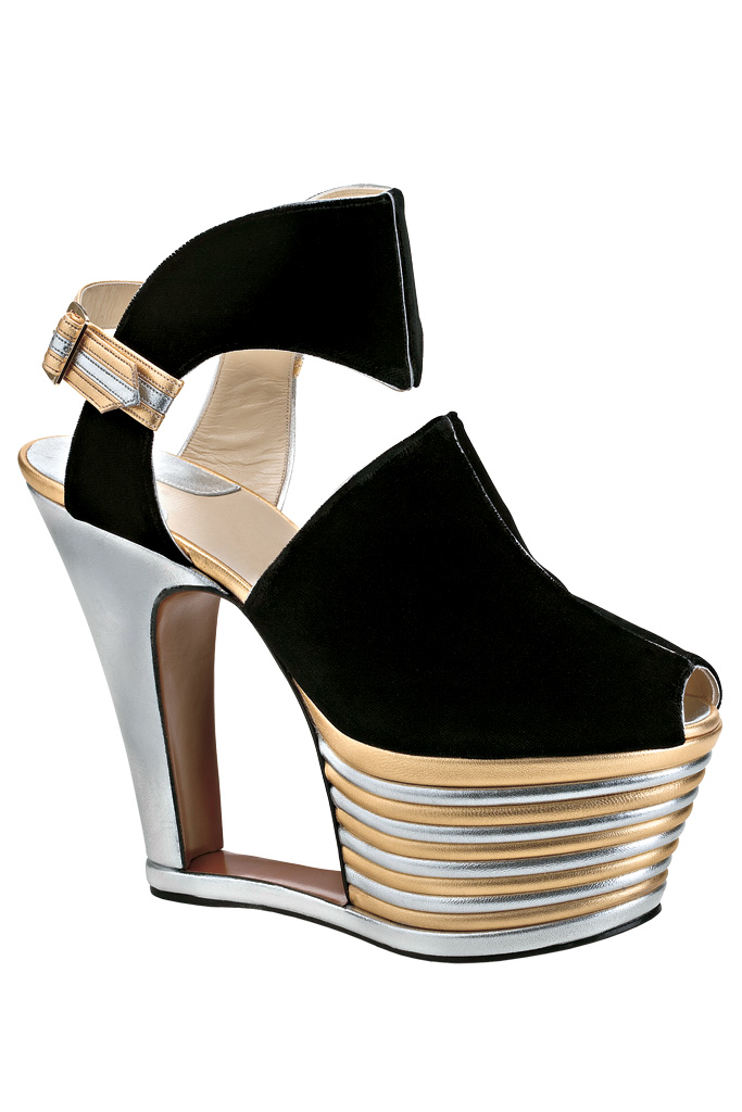 1938, Salvatore Ferragamo: The extreme structure of this exaggerated platform was originally created to give petite Hollywood starlets serious height. Current Creative Director Massimiliano Giornetti designed an updated pair for the brand's new Beverly Hills flagship, opening in September.
