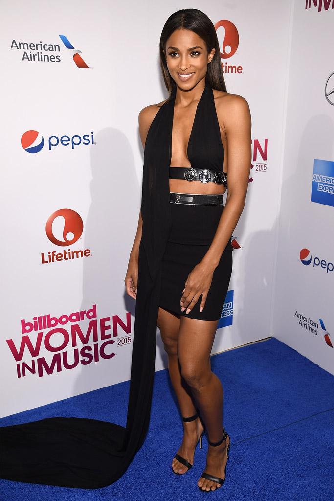 Ciara in a Versus ensemble and black sandals.