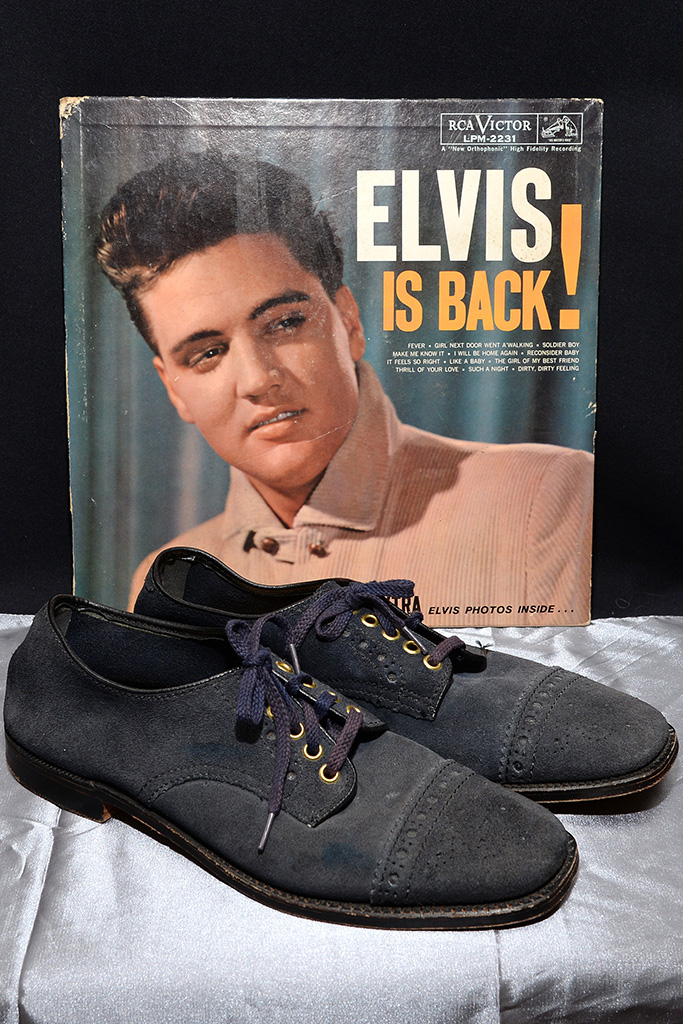 Elvis Presley's blue suede size 10 shoes from 1960 seen at a media preview presented by Julien's Auction at the Hard Rock Cafe in New York, NY, on December 3, 2013. (Photo by Anthony Behar/Sipa USA)