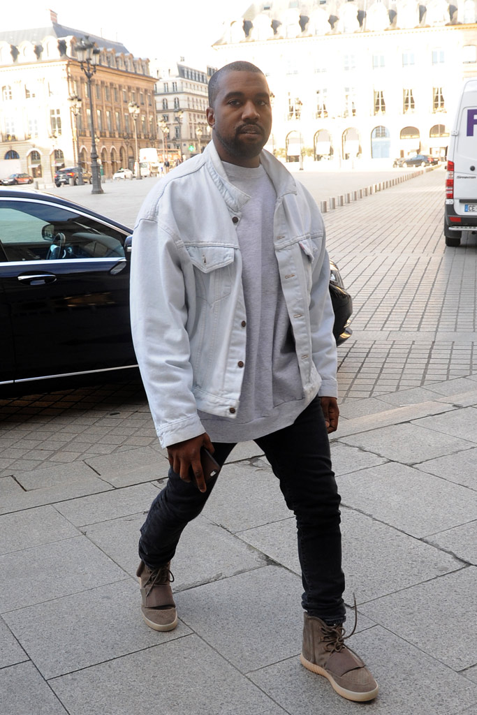 Kanye West in Paris wearing Yeezy Boost 750s.