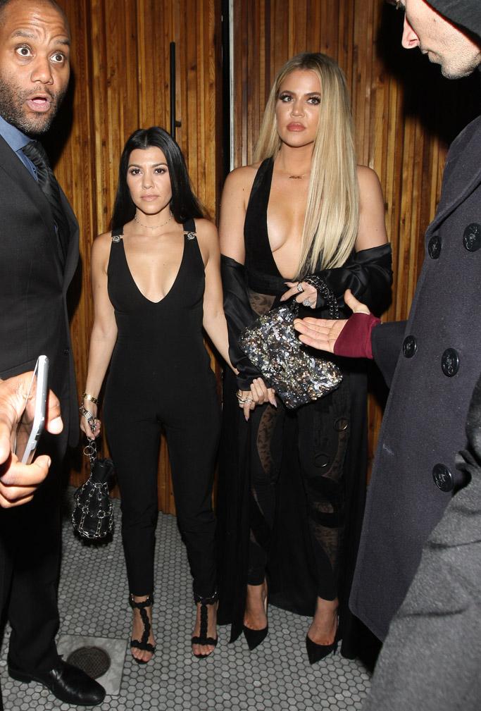Kourtney Kardashian wore Alaia sandals while Khloe wore black pumps.