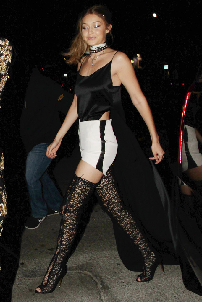 Gigi Hadid wearing thigh-high Tom Ford lace-up boots from the designer's spring '14 collection.