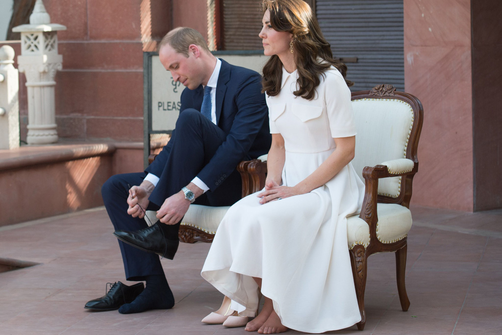 The Duke and Duchess removed their shoes as they paid respects.