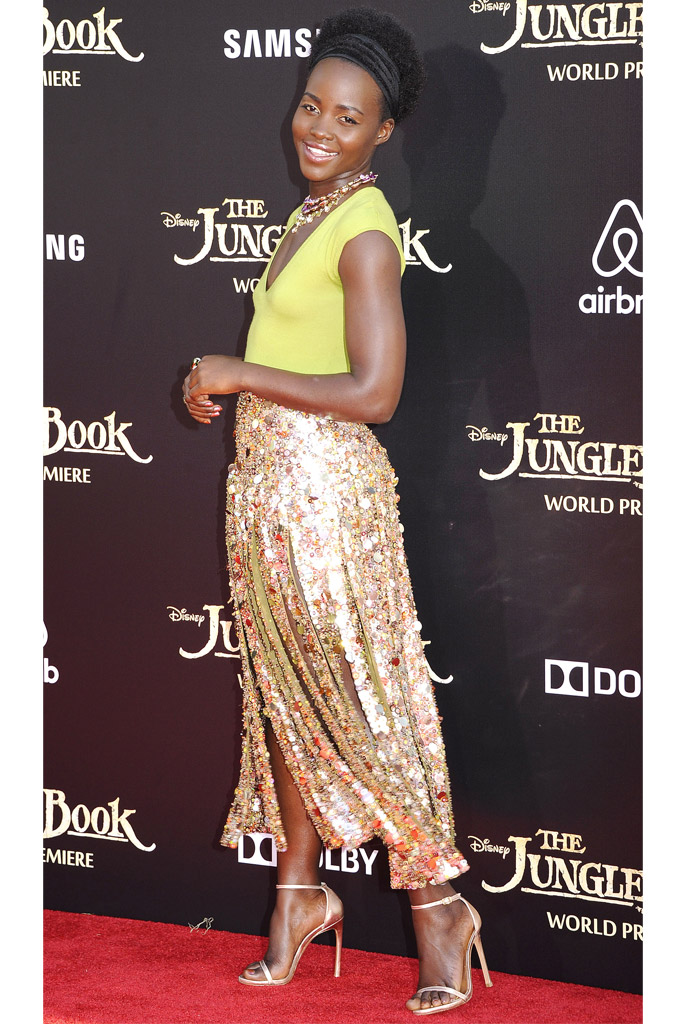 Lupita Nyong'o wearing Stuart Weitzman heels. and J.Crew skirt.
