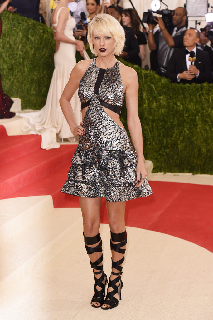 Taylor Swift on the red carpet in knee-high sandals.