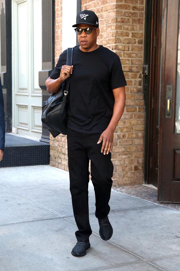 Jay Z wearing black Yeezy Boost 350s.