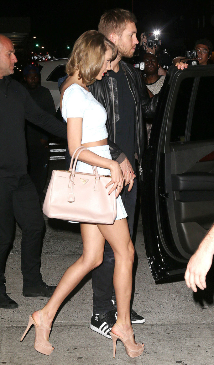May 2015: Swift on a date with Calvin Harris while wearing Prada heels.