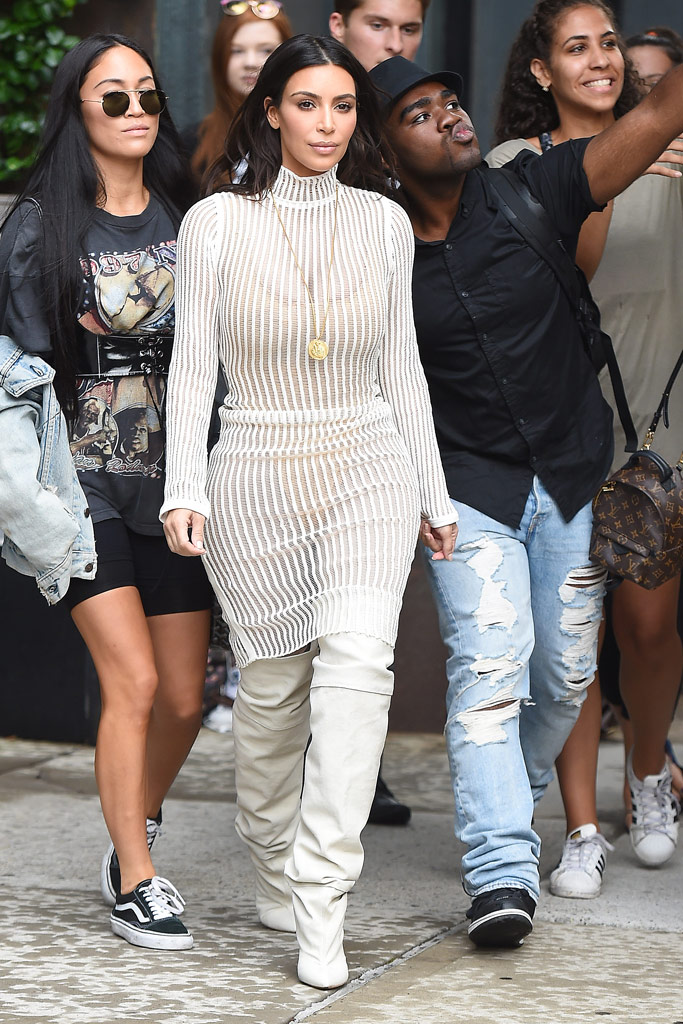 Kim Kardashian West wearing boots from the Yeezy Season 4 collection to the show.