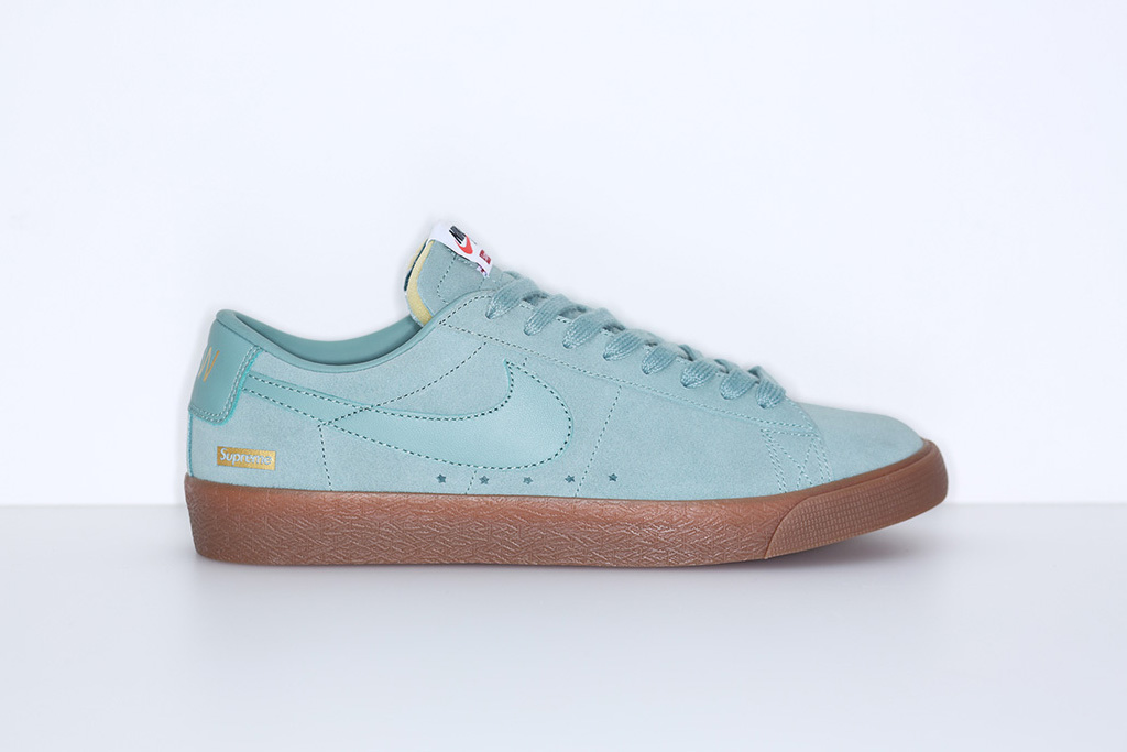 The Supreme x Nike SB Blazer Low GT features a gum outsole.