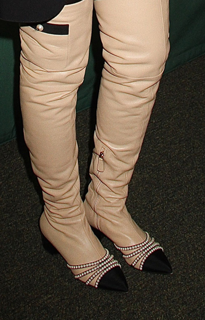 Detail of Taraji P. Henson's Chanel boots featuring pearls.