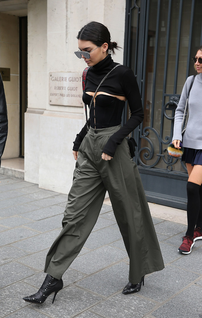 Kendall Jenner was spotted at Paris Fashion Week wearing studded, woven booties by Givenchy.