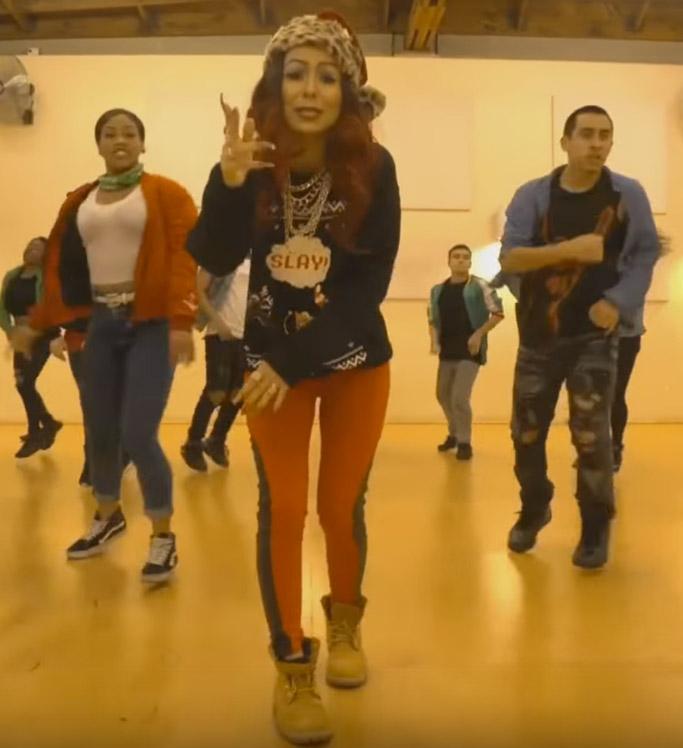"Bon Qui Qui wears Timberland boots in ""Jingle Bells Slay"" off her ""Merry Hoodmas"" EP."