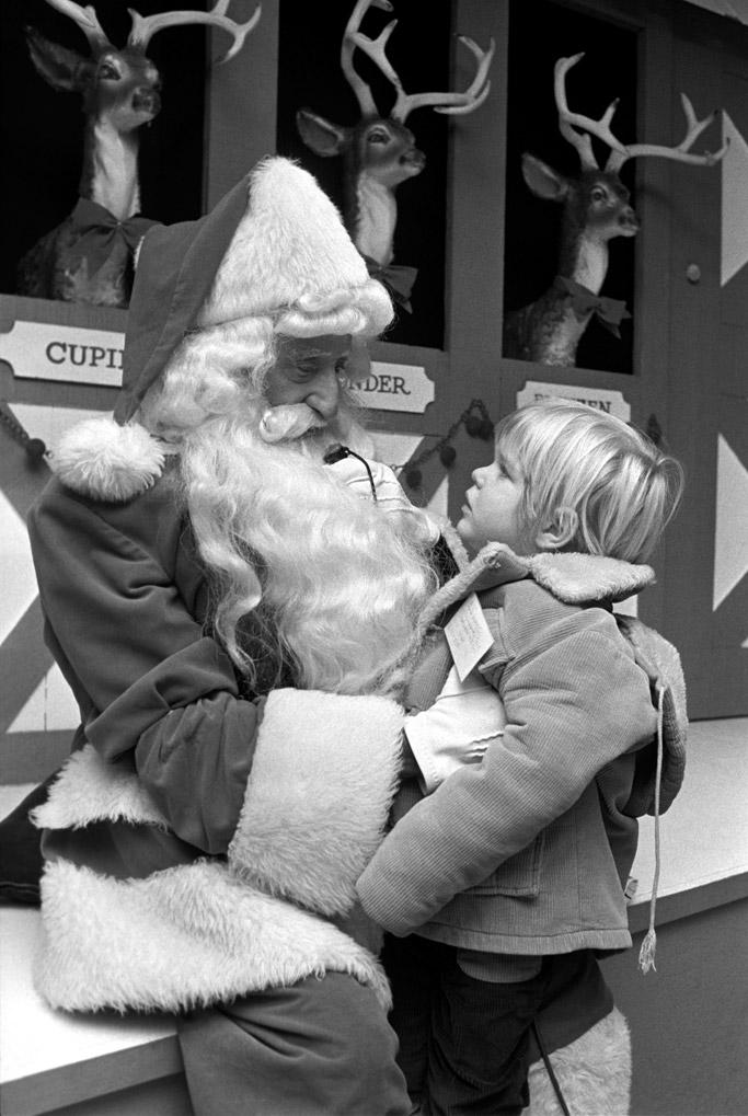 A little boy meets Santa at Macy's.