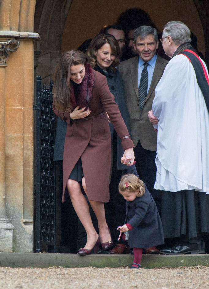 Princess Charlotte plants a candy cane in the ground after Christmas Day church services.
