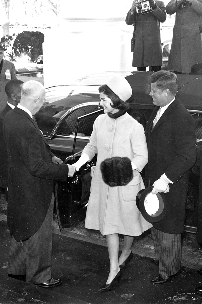 U.S. President Dwight Eisenhower shakes hands with Jacqueline Kennedy as she and President-elect John F. Kennedy arrive at the North Portico of the White House in Washington, D.C., on inauguration day, Jan. 20, 1961. (AP Photo)