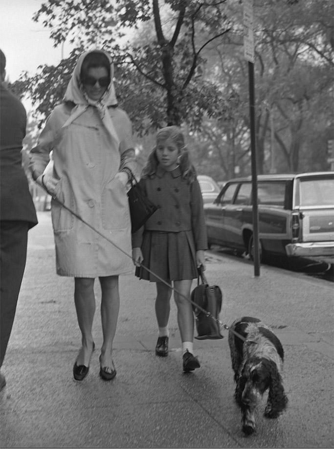Jackie Kennedy walks Caroline to school with thier dog.