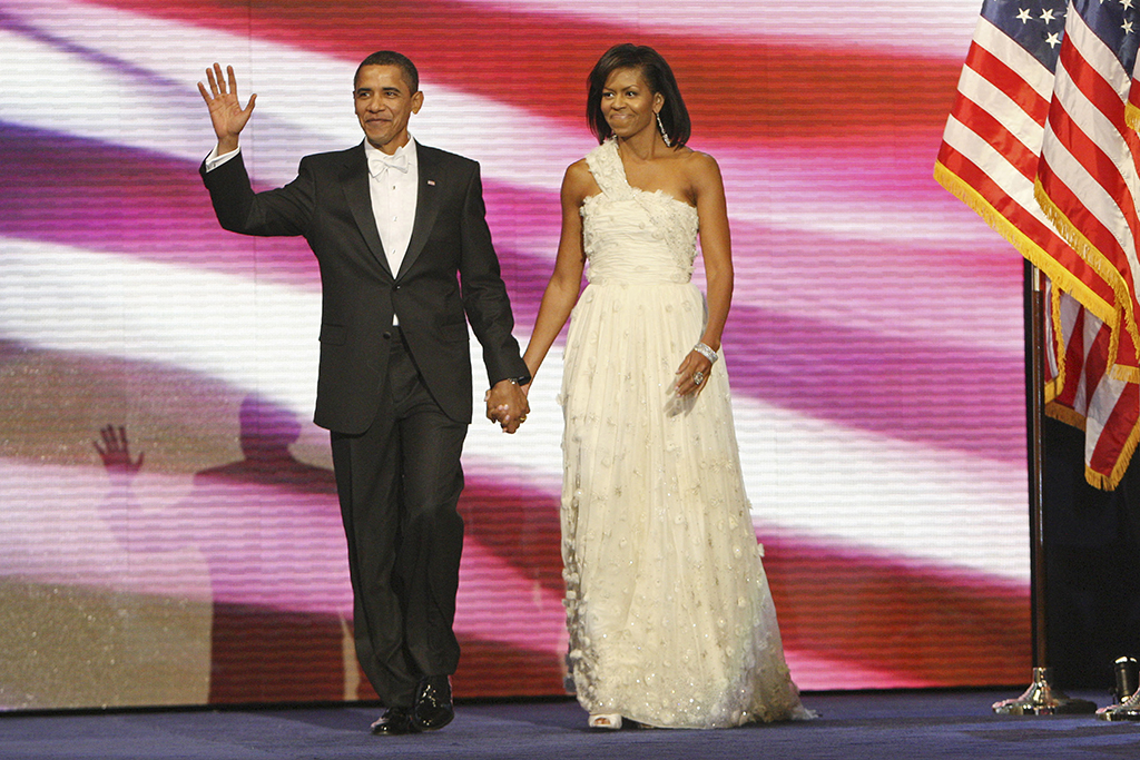 President Barack Obama, left, and first lady Michelle Obama, right, are introduced at the Neighborhood Inaugural Ball in Washington, Tuesday, Jan. 20, 2009. (AP Photo/Pablo Martinez Monsivais)