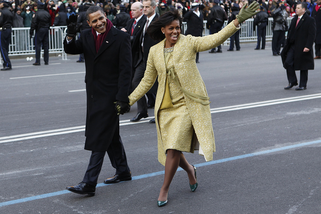 President Barack Obama and first lady Michelle Obama walk the inaugural parade route in Washington, Jan. 20, 2009. (AP Photo/Charles Dharapak)