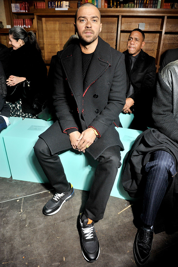 Jessie Williams sitting front row at Givenchy.