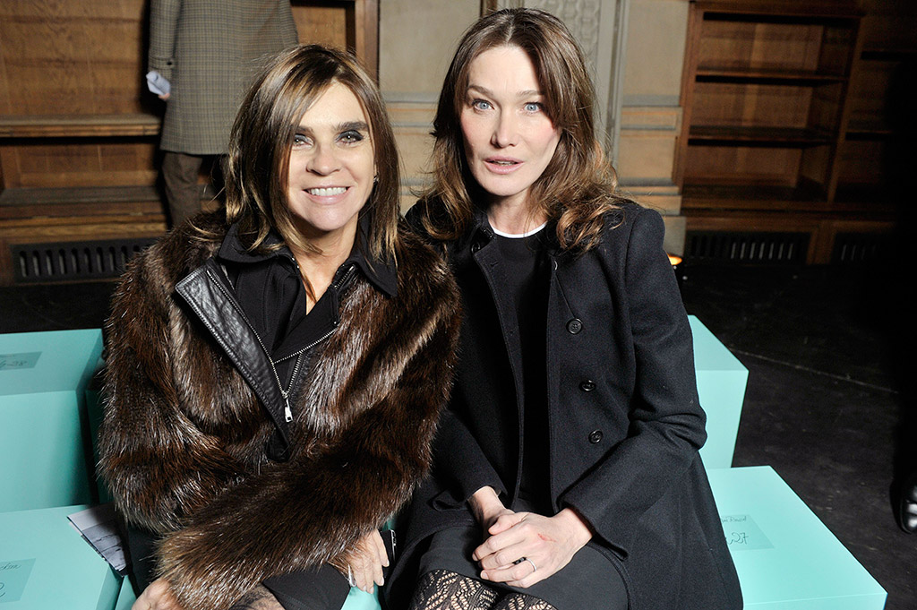 Carine Roitfeld and Carla Bruni-Sarkozy sit front row.
