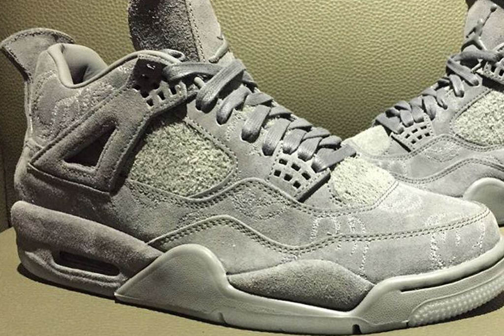 The Kaws x Air Jordan 4 features engraved details.