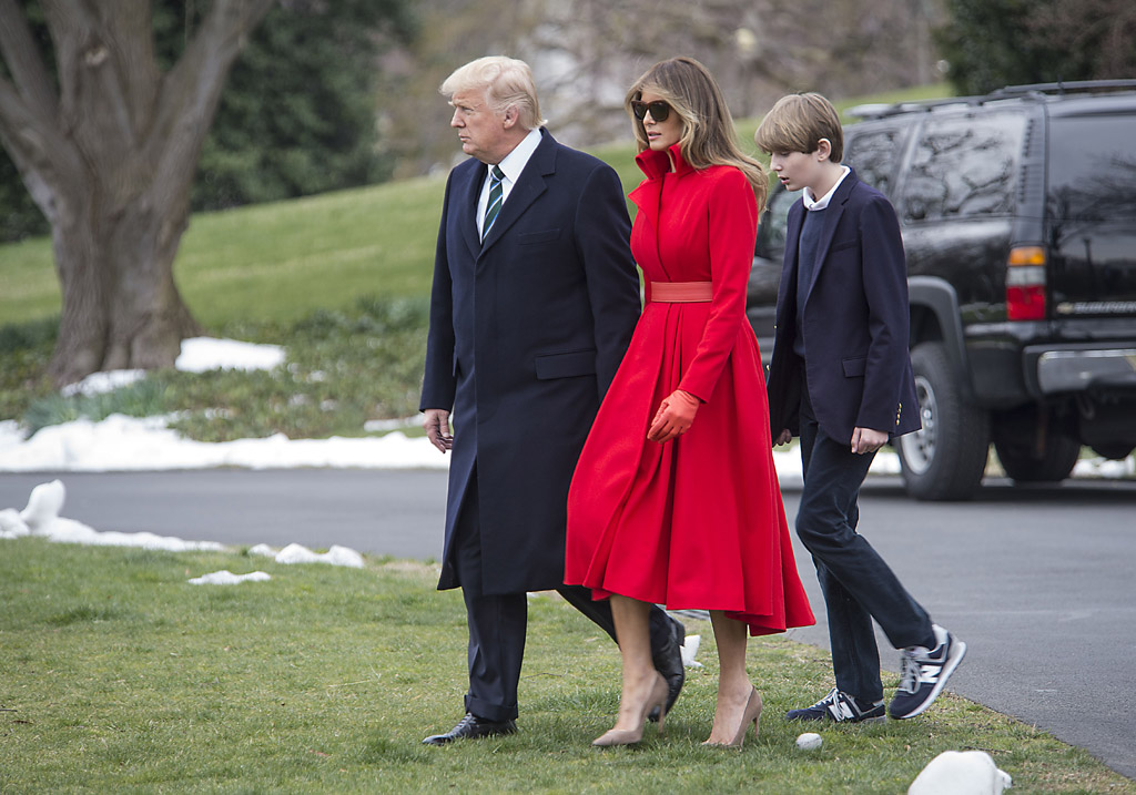melania trump red coat dress nude pumps white house weekend donald son barron