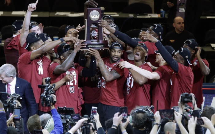 Copyright 2017 The Associated Press. All rights reserved. This material may not be published, broadcast, rewritten or redistributed without permission.Mandatory Credit: Photo by AP/REX/Shutterstock (8553985bt)South Carolina players celebrate after beating Florida 77-70 in the East Regional championship game of the NCAA men's college basketball tournament, in New YorkNCAA South Carolina Florida Basketball, New York, USA - 26 Mar 2017