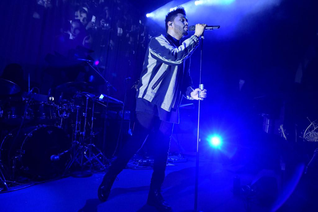 The Weeknd performing during H&M's Paris Fashion Week.