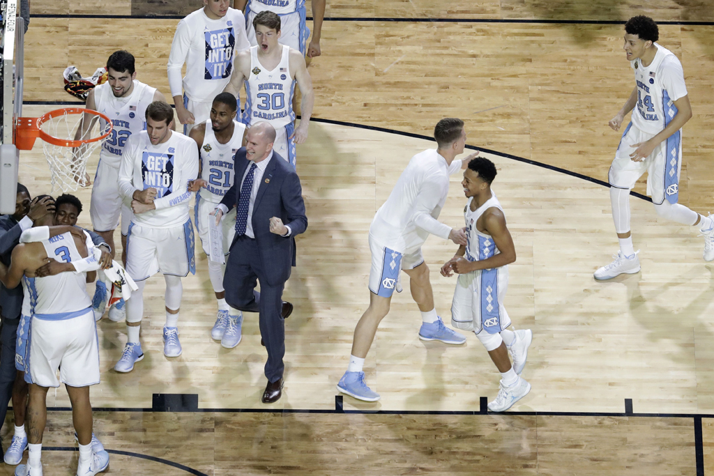 Copyright 2017 The Associated Press. All rights reserved. This material may not be published, broadcast, rewritten or redistributed without permission.Mandatory Credit: Photo by AP/REX/Shutterstock (8561410cn)North Carolina players celebrate at the end of a semifinal against Oregon in the Final Four NCAA college basketball tournament, in Glendale, Ariz. North Carolina won 77-76Final Four Oregon North Carolina Basketball, Glendale, USA - 01 Apr 2017